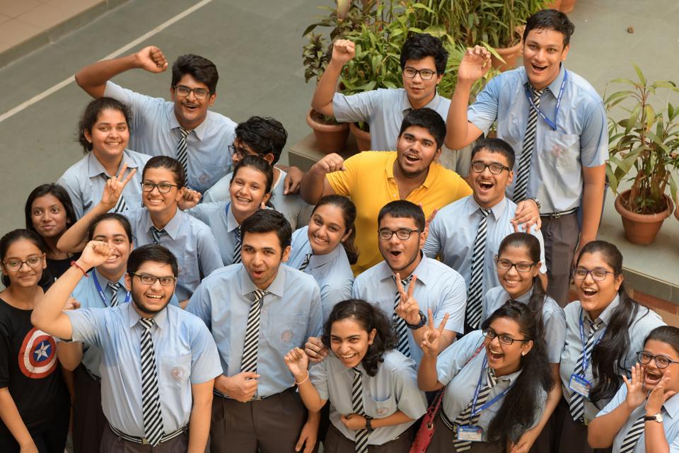 Students celebrate CBSE Class 12 results at Apeejay School, Nerul in Navi Mumbai on Saturday.