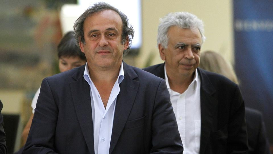 Former UEFA President Michel Platini (L) has been cleared by Swiss authorities of any criminal wrongdoing over payments he received from FIFA.