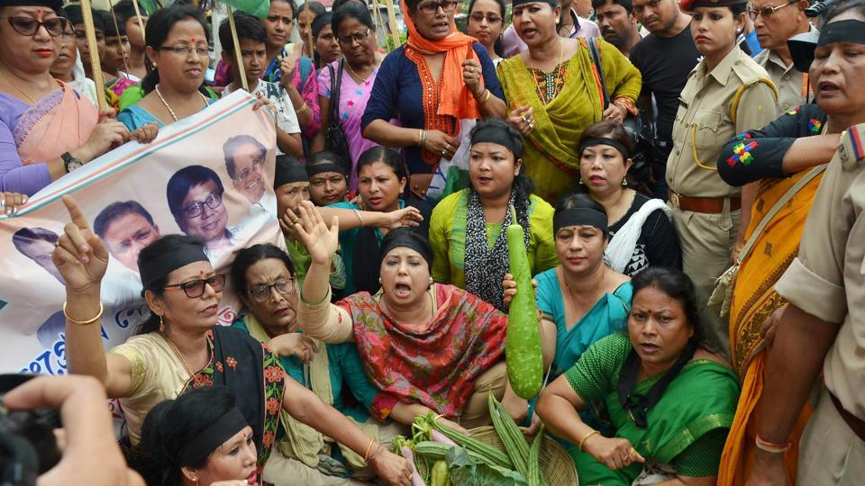 Members of Assam Pradesh Mahila Congress Committee stag a demonstration against steep hike in the prices of petrol and other essential commodities, in Guwahati on Saturday.