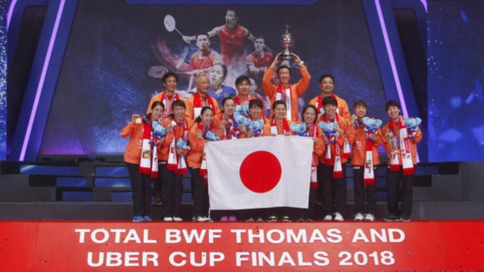 The Japanese badminton team celebrates after winning the Uber Cup in Bangkok on Saturday.