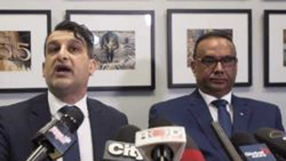 Jaspal Atwal, right, listens to his lawyer Rishi T. Gill during a news conference in downtown Vancouver, British Columbia, Thursday, March, 8, 2018.