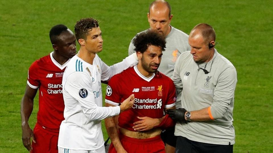 Liverpool's Mohamed Salah with Sadio Mane and Real Madrid's Cristiano Ronaldo as he is substituted after sustaining an injury during the Champions League final in Kiev on Saturday.