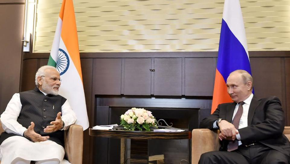 Prime Minister Narendra Modi and Russian President Vladimir Putin speaking during their meeting in Sochi on May 21.
