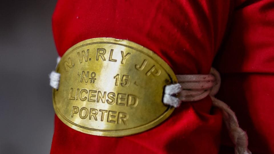 A detail view of Manju Devi's porter licence badge no. 15 as she waits for passengers on a platform at the railway station, in Jaipur. Devi was among 112 women who were felicitated by the Ministry of Women and Child Development as 'First Ladies', celebrating women who have breached barriers and registered a first in their areas of engagement.  (Arun Sharma / PTI)