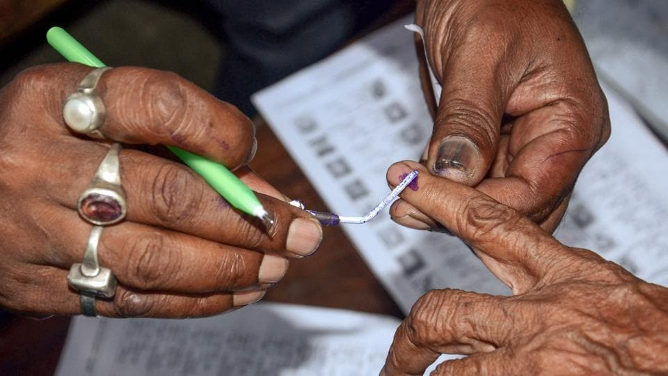 Howrah: Polling officials put an ink mark on a voter's finger after during Panchayat Election at a polling booth in Howrah district of West Bengal on Monday. (PTI Photo) (PTI5_14_2018_000201A)