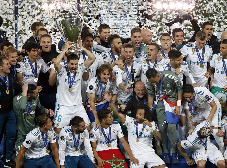 Real Madrid's Nacho lifts the trophy after winning the Champions League Final soccer match between Real Madrid and Liverpool at the Olimpiyskiy Stadium in Kiev, Ukraine.
