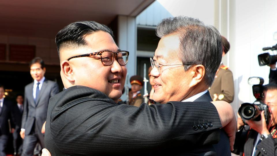 South Korean President Moon Jae-in (right) bids farewell to North Korean leader Kim Jong Un as he leaves after their summit at the truce village of Panmunjom, North Korea, on Saturday.