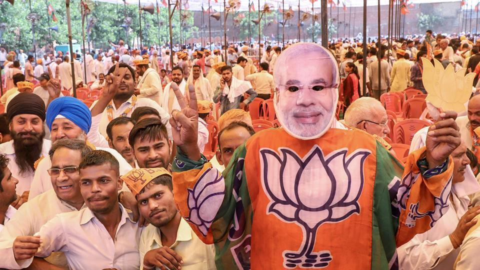 BJP supporters during Uttar Pradesh chief minister Yogi Adityanath's rally ahead of Kairana Assembly bypoll, in Shamli, on May 24.