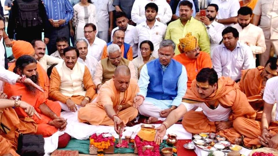 UPCM Yogi Adityanath lays the foundation stone for a state guest house in Haridwar on Monday as TS Rawat looks.