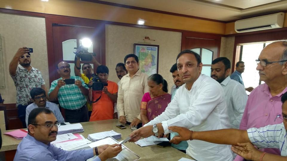 Congress leader Sachin Sawant hands over the complaint to Palghar collector Dr Prashant Narnaware on Sunday.