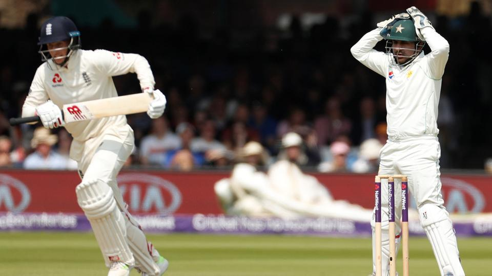 Pakistan's Sarfraz Ahmed (R) reacts as England's Joe Root takes a run during the first Test vs England at Lord's. Pakistan have been fined for a slow over-rate in the first Test.