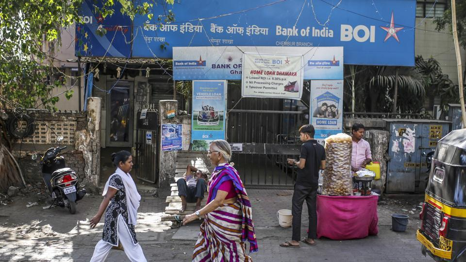 Pedestrians walk past a Bank of India (BOI) branch in Mumbai, India, on Sunday, April 22, 2018. BOI is scheduled to announce full year earnings on May 22. Photographer: Dhiraj Singh/Bloomberg