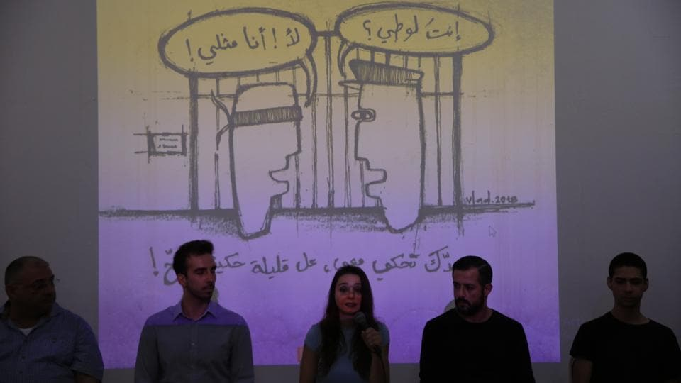 "Members of Helem speak during a press conference in Beirut. Arabic on the wall reads ""Are you a sodomite? No I am homosexual. If you want to talk to me, at least do it properly."" Lebanon's activists in collaboration with Palestinians, have introduced a new, positive Arabic word for homosexual, ""mithli,"" to replace the more common, derogatory term, ""shazz,"" or ""deviant."" (Hassan Ammar / AP)"