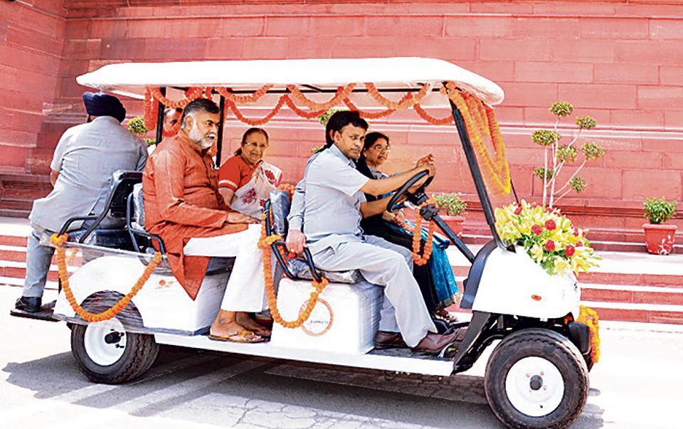 Lok Sabha Speaker Sumitra Mahajan rides an e-rickshaw in the Parliament complex.