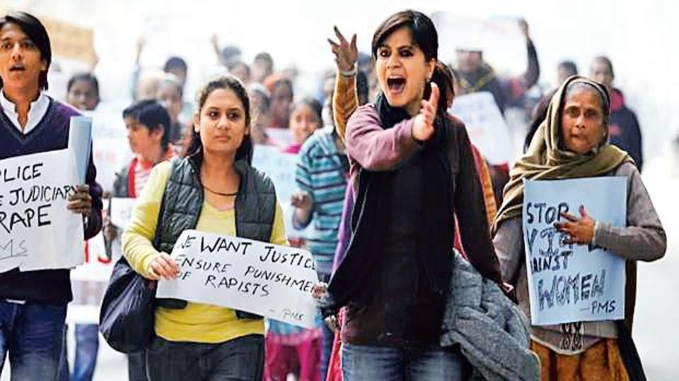 A file photo of people protesting against the gang rape of a woman in New Delhi.