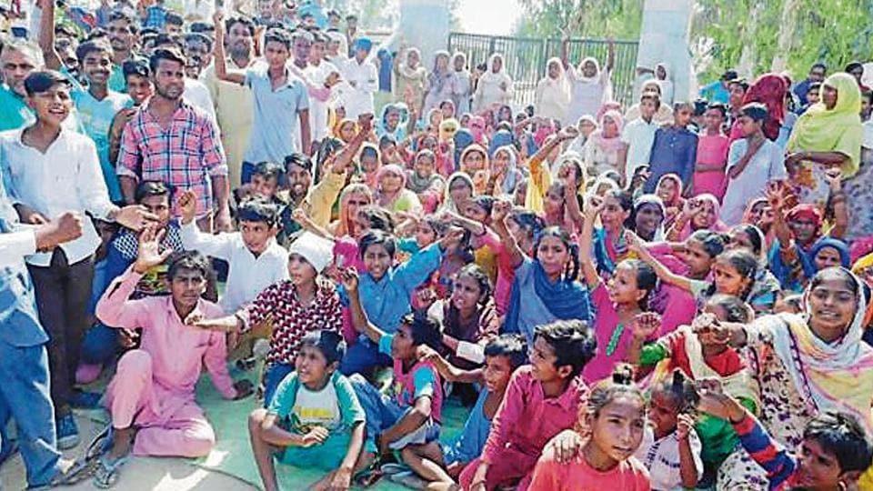 student thrashed by teacher,teacher confines student,residents lock school