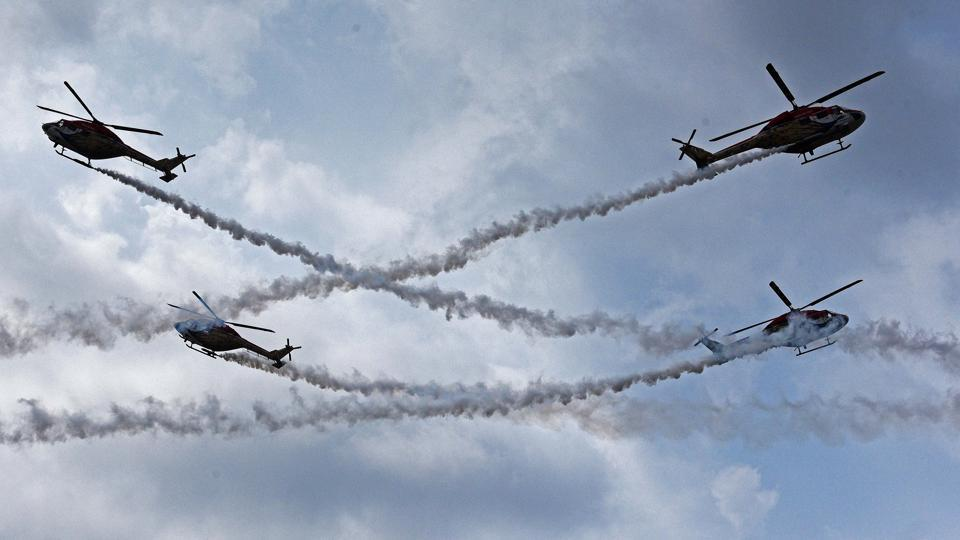 The Sarang helicopter team displays formations during PT & Equitation display during the convocation ceremony of 134th course of National Defence Academy (NDA) in Pune. (Pratham Gokhale/HT Photo)