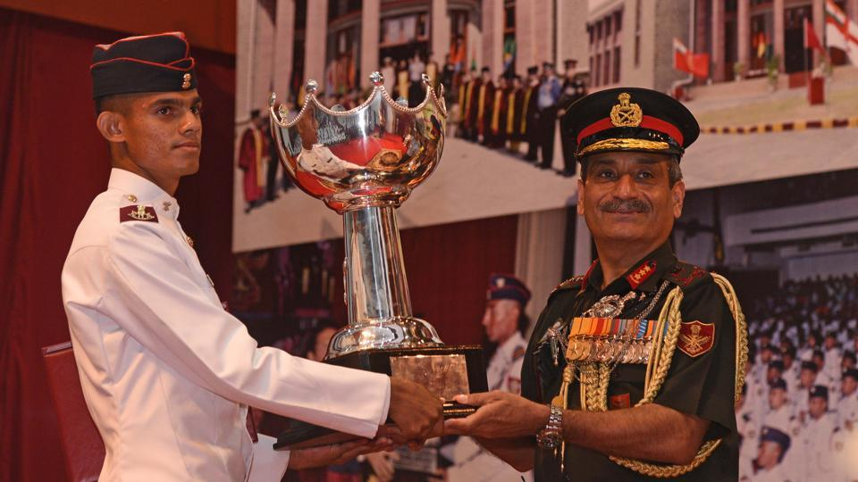 Cadet Mittal Prajapati receives award from the chief guest, Lieutenant General Satish Dua, current Chief of Integrated Defence Staff to the Chairman Chiefs of Staff Committee of the Indian Armed Forces during the convocation ceremony of 134th course of National Defence Academy (NDA) in Pune. (Pratham Gokhale/HT Photo)