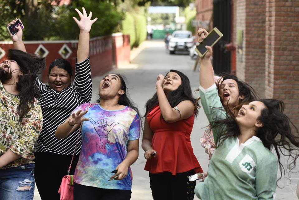 Students of St. Thomas' Girls Senior Secondary School celebrate after the Central Board of Secondary Education (CBSE) announced results of the Class 10 board examinations, in New Delhi. A total of 16,38,420 candidates registered for the Class 10 exam conducted at 4,453 centres across India and 78 centres abroad. (Burhaan Kinu / HT Photo)
