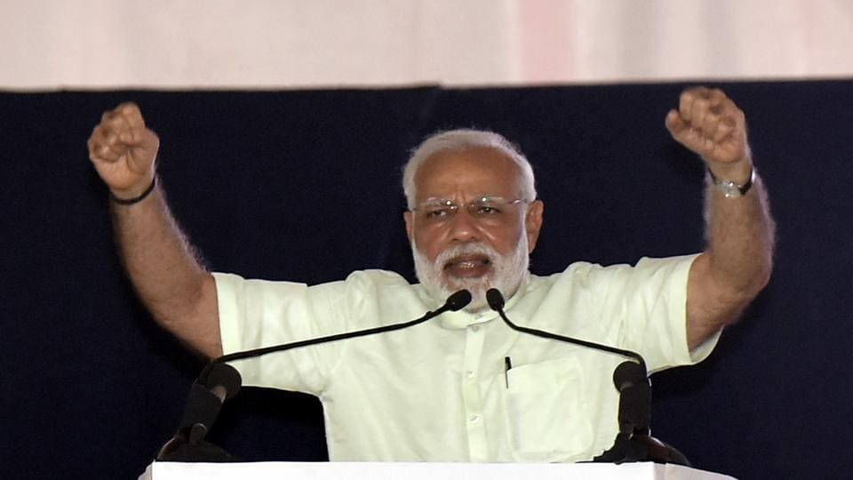 PM Narendra Modi gestures during a rally after the inauguration of the 135km long Eastern Peripheral Expressway (NH-II), at Bagpat in Uttar Pradesh.