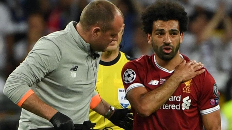 Mohamed Salah was forced out of the Champions League final in tears on Saturday clutching his left shoulder after being wrestled to the ground by Real Madrid captain Sergio Ramos