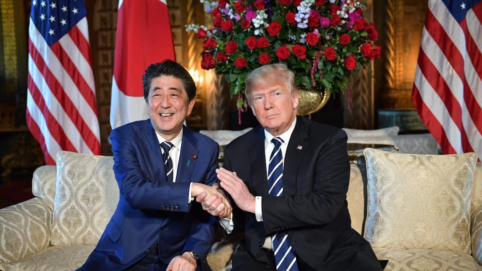 In this file photo taken on April 17, 2018, US President Donald Trump greets Japanese Prime Minister Shinzo Abe at Trump's Mar-a-Lago resort in Palm Beach, Florida. Trump and Abe agreed on May 28, 2018, that it is