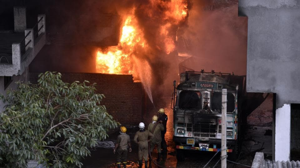 Firefighters attempt to douse a massive fire that broke out at a plastic and rubber warehouse near a school at south Delhi's Malviya Nagar in New Delhi.