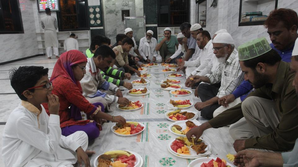 Hindus and Muslims share the iftar meal at Furqan Masjid in Mumbra on Sunday.
