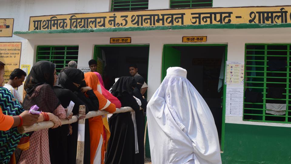 Muslim voters at Prathmik Vidyalaya booth in Thana bhawan Shaml in Kairana.