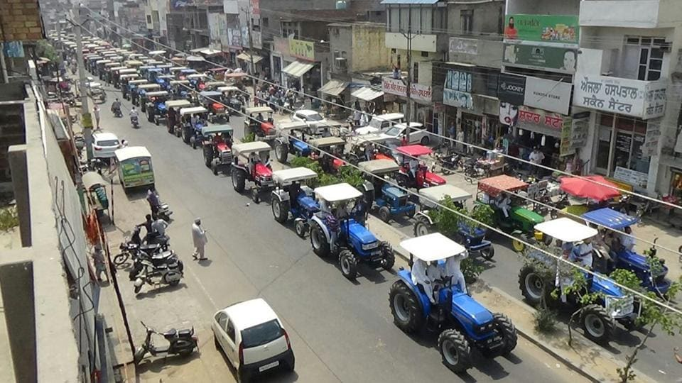 Members of Bharti Kisan Union (BKU) taking out a tractor rally at Samrala near Ludhiana on Tuesday.