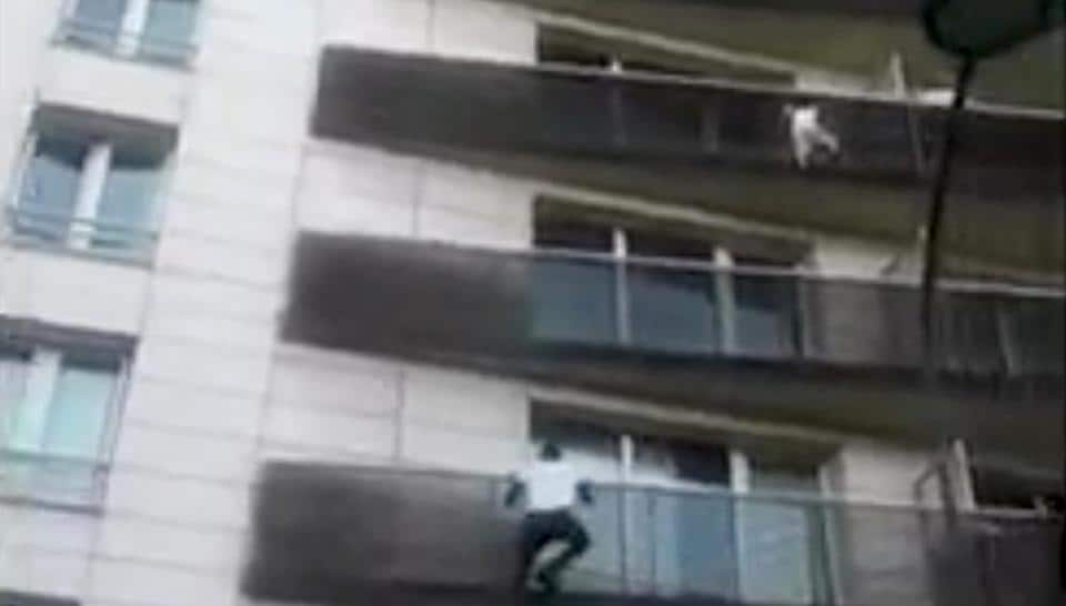 Mali immigrant rescues dangling child from balcony in Paris, France.