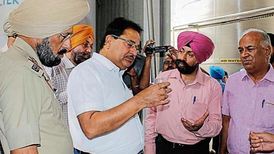 Punjab environment minister OP Soni with officials during his visit to a distillery of the Bhagat Industrial Corporation Limited, Khasa, near Amritsar on Tuesday.