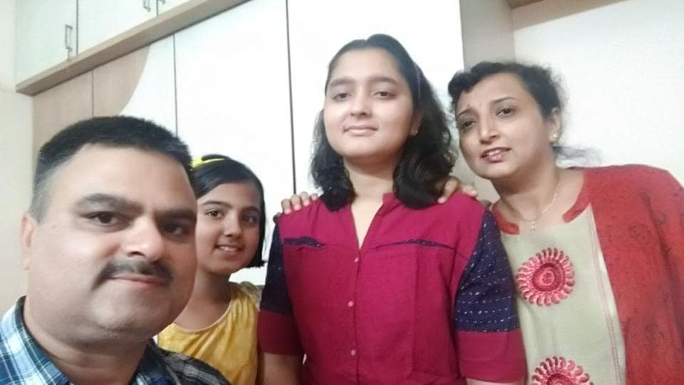 City-topper, Prerna Tulsiani, who scored 99 per cent, with her family in Nigdi on Tuesday.