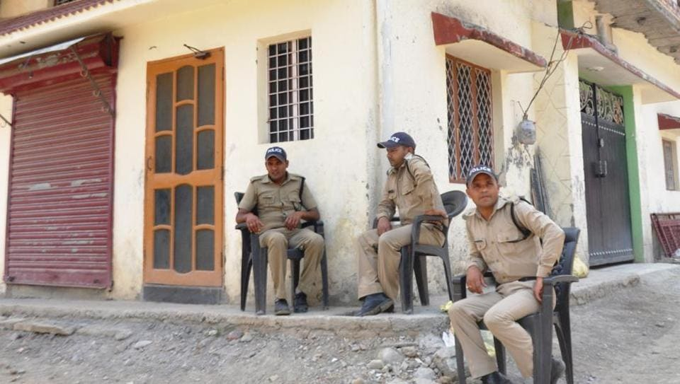 Police deployed outside the girl's house in Dehradun on Wednesday.