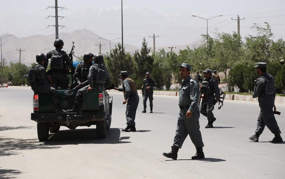 Security personnel arrive at the site of an attack in the Afghan Interior Ministry in Kabul, Afghanistan, Wednesday, May 30, 2018.