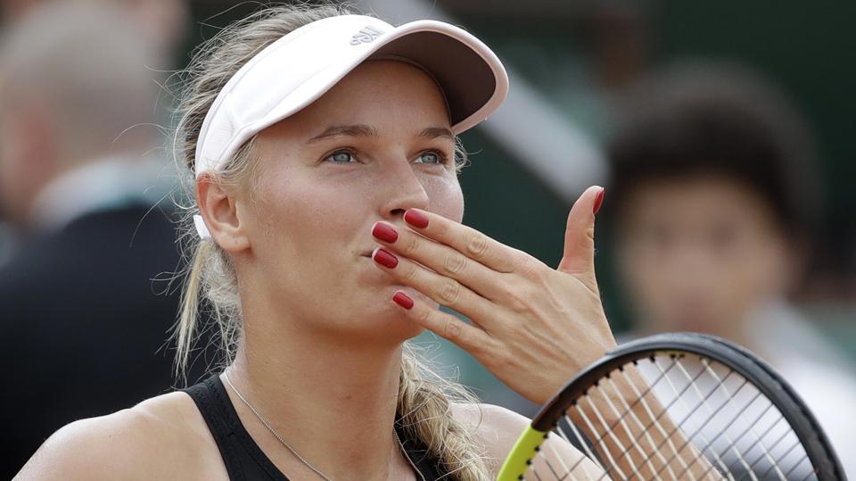 Caroline Wozniacki celebrates after defeating Spain's Georgina Garcia Perez during their French Open second round match.