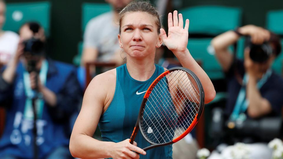 Simona Halep celebrates after winning her French Open first round match against Alison Riske on Wednesday.