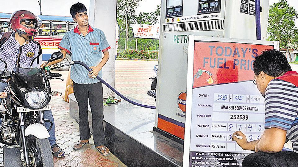 An employee updates fuel prices display board at a petrol pump, in Howrah on Wednesday. Fuel prices have risen continuously every day for the past fortnight.