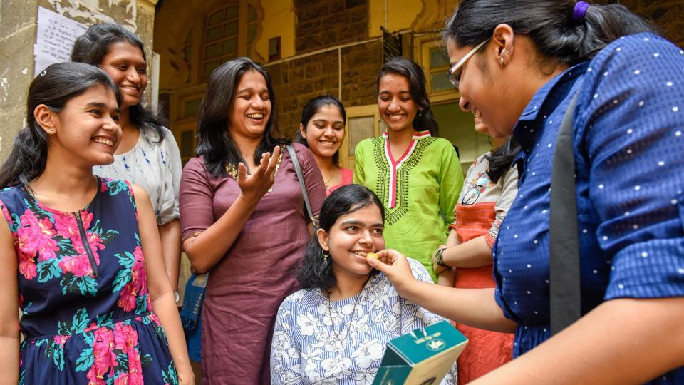 Vanshika Joshi, a disabled student who scored 71% in the Higher Secondary Certificate examination, congratulated by other toppers at SP College in Pune on Wednesday.