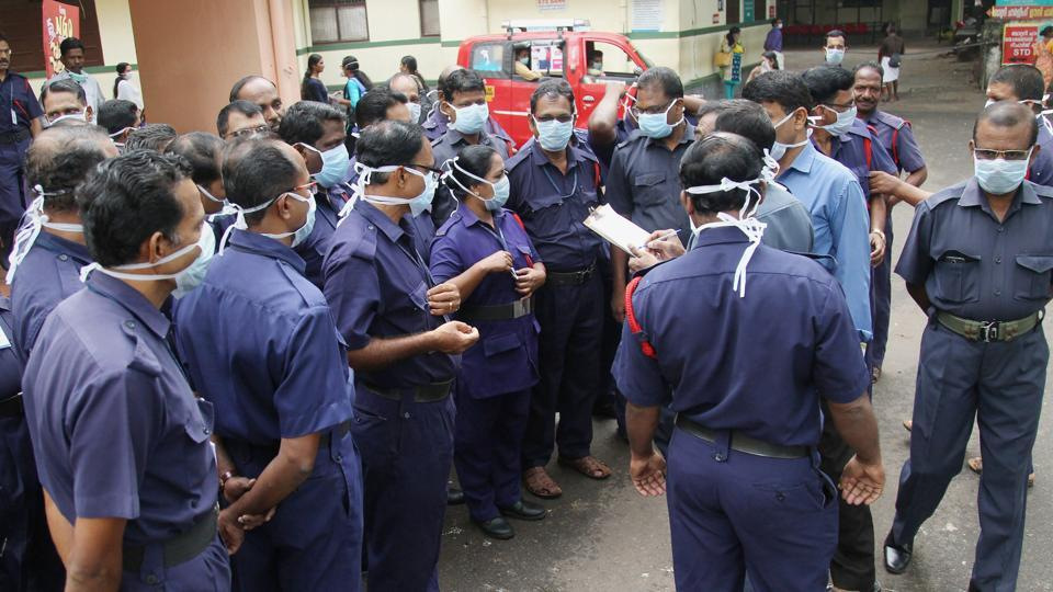 Security staff being given instructions by the head after the outbreak of Nipah virus at Medical College in Kozhikode on May 26, 2018.