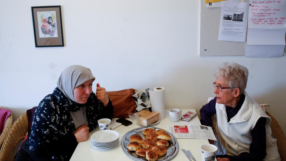 Palestinian Amnah Hamad (L), having lived in Denmark for 30 years, learns to speak Danish from Anni Olsen who volunteers to teach Danish to immigrants. Denmark has struggled integrating immigrants into its welfare state. Public debate intensified in 2015 with the arrival of large groups from conflicts in the Middle East and North Africa. (Andrew Kelly / REUTERS)