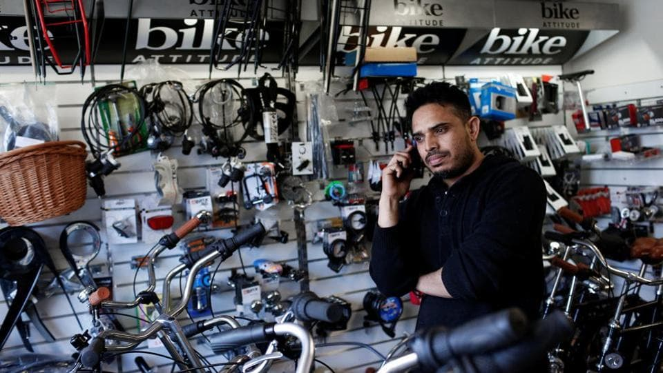 John Khan, originally from Pakistan and now a resident in Mjolnerparken, takes a telephone call in his bicycle shop, Alaska Cykler in Copenhagen. The plan has met with a mixed response in Mjolnerparken, one of the country's 25 ghettos - a term that originated in 16th-century Venice and was used to describe areas of the city to which Jews were restricted. (Andrew Kelly / REUTERS)