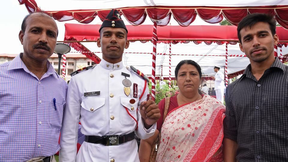Bronze medalist cadet Ali Ahmed Choudhury poses for photo with his family members after passing out parade of 134th course of spring term 2018 at National Defence Academy (NDA) in Pune. (Pratham Gokhale/HT Photo)