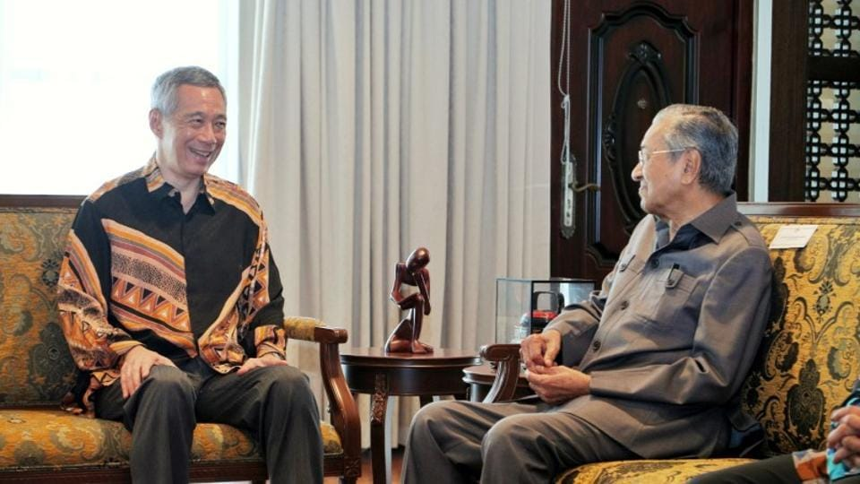 Malaysia's Prime Minister Mahathir Mohamad with Singapore's Prime Minister Lee Hsien Loong at the Perdana Leadership Foundation in Putrajaya, Malaysia on May 19, 2018 in this handout photo.  Malaysia's PM said his government planned to develop some offshore rocks which were the subject of a territorial dispute with Singapore.