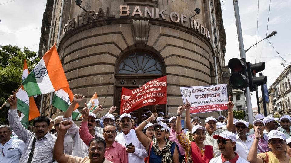 Bank workers shout slogans during a protest outside Central Bank branch, Fort in Mumbai, India, on Wednesday, May 30, 2018. Bank employees are staging a two-day nationwide strike, for their demands.