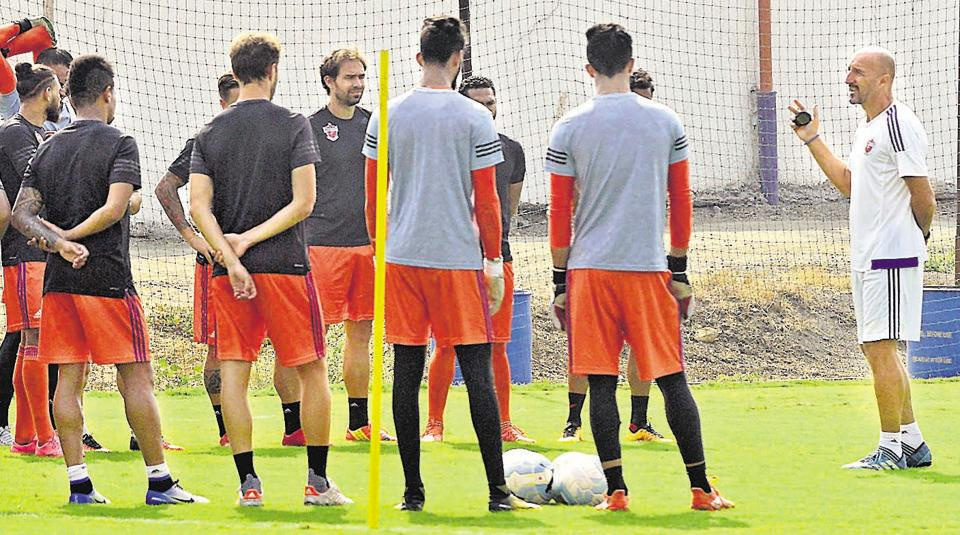 Players of FC Pune City along with former head coach Ranko Popovic (extreme right) during one of their practice sessions at Pune FC training pitch, Pirangut.