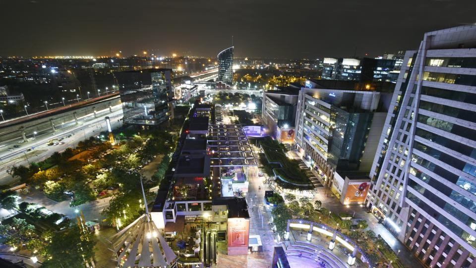 An aerial view of CyberHub and the larger Gurugram cityscape at night. Spanning options that cater to a wide demographic and accommodate all sorts of preferences, the CyberHub sits as the perfect leisure designation in cosmopolitan Gurugram. (Sanjeev Verma / HT Photo)