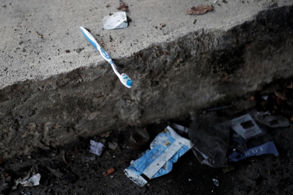 "A toothbrush is seen on the ground near tents after the evacuation. Two other makeshift camps in Paris holding some 1,000 migrants are expected to be cleared next week. ""To stay one month here is very, very, very bad for me. All the people have sicknesses and don't have food,"" said Farouk Ahmed from Sudan. (Benoit Tessier / REUTERS)"