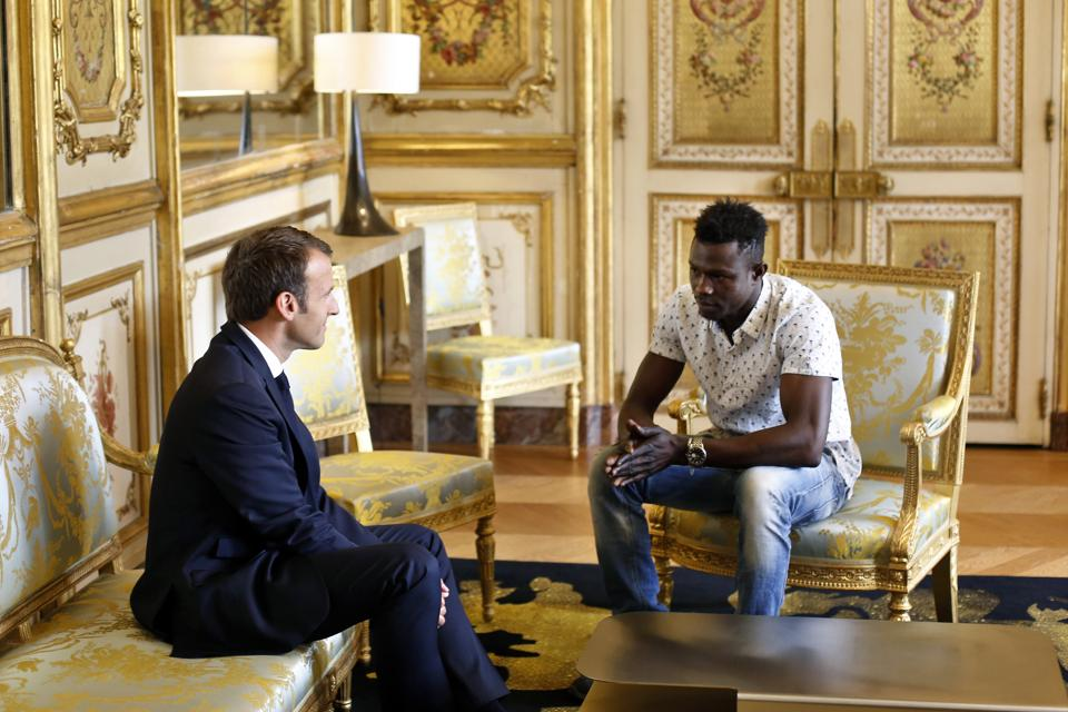 "President Emmanuel Macron wants a tough response to migrants arriving in France. Just this week, he nevertheless opened the way to citizenship and a job for a Malian migrant who scaled a building and saved a young child dangling from a balcony in what he called ""an exceptional act."" A video of Mamoudou Gassama's feat went viral, gaining him the nickname ""Spiderman."" (Thibault Camus / Pool / AP)"