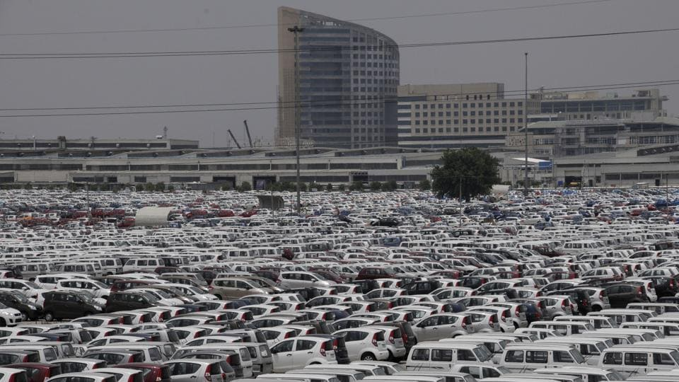 A sea of Maruti Suzuki vehicles seen lined up at the company's IMT Manesar plant in Haryana. From those initial days, Maruti has grown exponentially into an automobile behemoth just as its birthplace Gurugram has as a metropolis. The monolithic Maruti Suzuki factory today is one of countless manufacturing and economic entities that make up Gurugram.  (Parveen Kumar / HT Archive)
